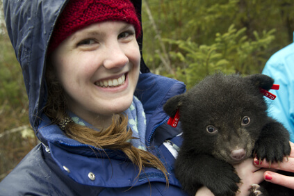 Student with bear cub