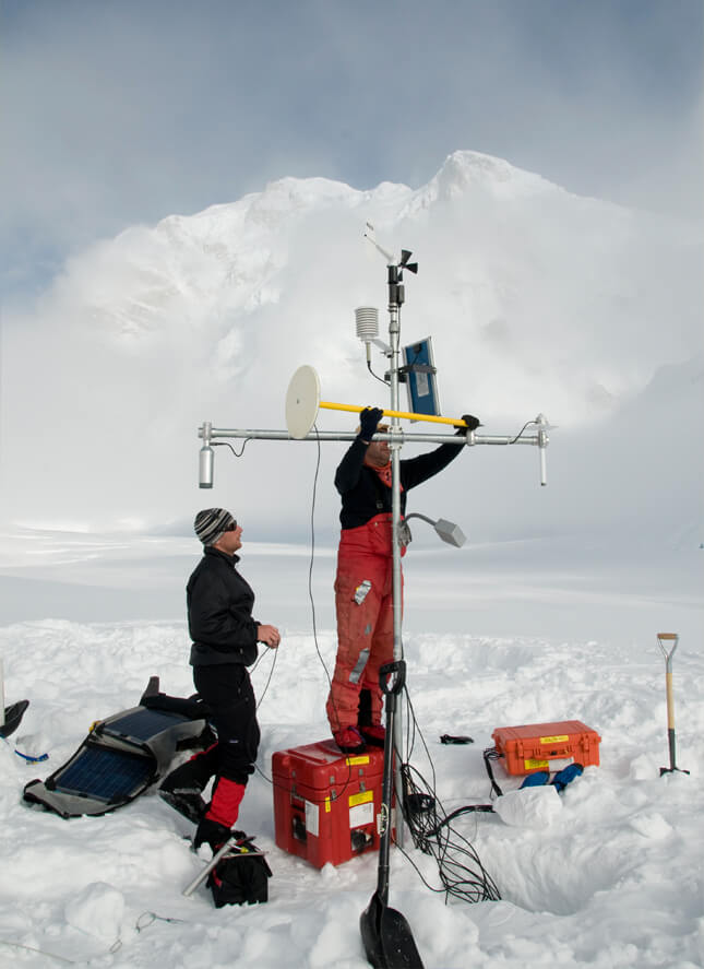 Scientists in the field with equipment