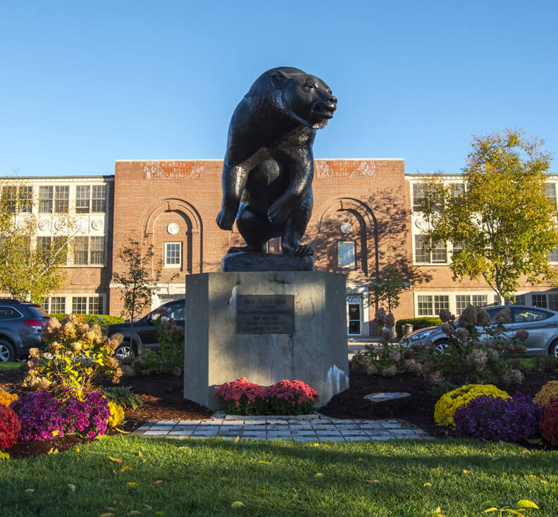 Black Bear statue in front of UMaine's New Balance Field House