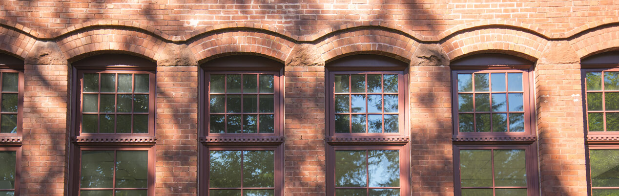 Windows in the side of a brick building