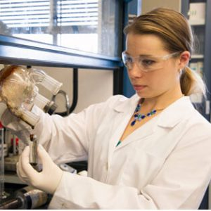 Female engineering student works in lab